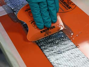 Wetting out the reinforcement sheet using the Belzona SuperWrap II fluid-grade resin